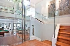 Clean lines: Walls of double-glazed glass, as well as a glass elevator can be found situated in the heart of the home