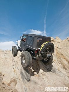 Web Wheeler 1997 Jeep Wrangler Climbing Rocks