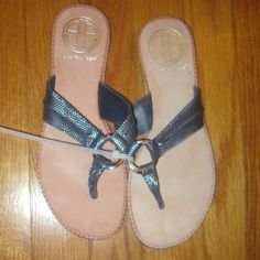 """Lilly Pulitzer McKim Flip Flops Thongs Sandals Size: 6.5. Approximately 9.5 inches from heel to toe ( Please measure your feet). Navy blue leather upper with metallic dots. Metal """" O"""" ring that says """" Lilly"""". Leather footbed . Rubber sole. Please note that box ISN'T included. Lilly Pulitzer Shoes Sandals"""