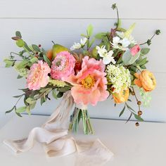 Lush florals posted by Southern Girl Weddings on The Wedding Pages.