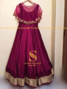 Beautiful maroon color floor lenght dress with net cape. Cape with hand embroidery zardosi work. Indian Fashion Dresses, Indian Gowns Dresses, Dress Indian Style, Indian Designer Outfits, Long Gown Dress, Anarkali Dress, Cape Gown, Long Frock, Kurti Designs Party Wear