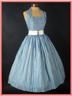 Crisp,cool,halter dress with cinch belt.
