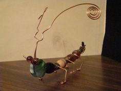 How to Make Beaded Bugs | Wired...Bugs, Wire, beads and glass are used to make these bugs ...