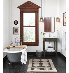 Classic bathroom with black clawfoot tub, single freestanding vanity, and smoked glass pendants Bad Inspiration, Bathroom Inspiration, Open Baths, Apartment Bathroom Design, Bathroom Designs, Small Bathroom, Modern Bathrooms, Luxury Bathrooms, Bathroom Mirrors
