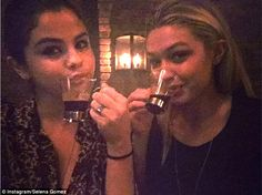 Old ladies! Selena Gomez, left, shared this picture of her and Gigi Hadid, right, sipping on espresso at a dinner party on Saturday