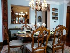 The family dining room table is set for six people and features a nice bar from the kitchen.