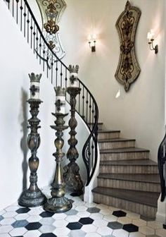 rustic yet chic and opulent foyer.. love the white and wood, and hugely oversized candlesticks!