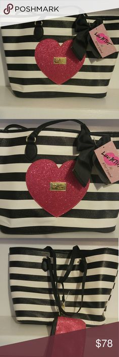 Betsey Johnson tote bag New with tags! Black white stripe tote! Classic tote with style. Comes with Pink wristlet . super cute bag!!Great yourself for Valentine's dayprice is firm ! Betsey Johnson Bags