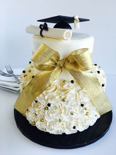 Classically elegant graduation cake in black white and gold. Perfect for high school and college graduates!