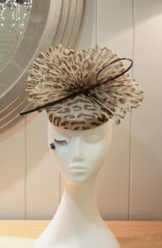 Cheetah print sinamay fascinator with pleated sinamay and quill accent
