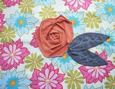 Knit roses on a quilt - looks beautiful and adds a unique 3D element.