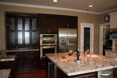 bianco antico with cherry cabinets - Google Search