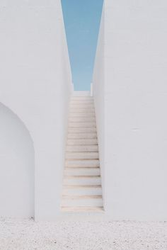 #Masseria Moroseta: a white stone farmhouse standing proudly on the ridge with views across the olive trees to the sea #white #Italy #staircase Project by Andrew Trotter Studio