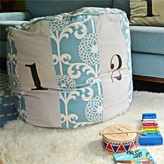 Land of Nod inspired number pouf using colorful Waverly fabric and bleached painters drop cloth.