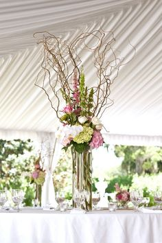 Similar to our centerpieces except different vase and flower color!