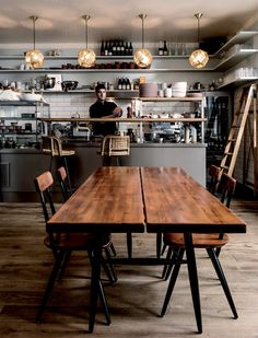 Industrial styled kitchen! We love the mix of wood, brick, and steel!