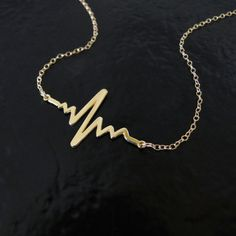 Gold Heartbeat Necklace Solid Gold Heart Beat by classicdesigns