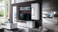 Wohnwand mit Sideboard Pamplona Weiß Hochglanz mit Riviera Eiche 20753. Buy now at https://www.moebel-wohnbar.de/wohnwand-mit-sideboard-pamplona-weiss-hochglanz-mit-riviera-eiche-20753