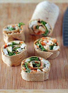 These healthy Buffalo Chicken Pinwheel Wraps are perfect as an afternoon snack or party food and are full of fiber and high in protein to satisfy. Just 152 calories or 4 Weight Watchers points for a snack serving! www.emilybites.com