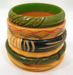 Vintage Bakelite bangles - I have one from my Canadian Great-Aunt. It is in the yellow color - larger and with similar incising to the top green one. Love it and just started to wear it. Vintage Costume Jewelry, Vintage Costumes, Vintage Outfits, Vintage Jewelry, Bangle Bracelets, Bangles, Jade Bracelet, Plastic Jewelry, Jewelry Accessories