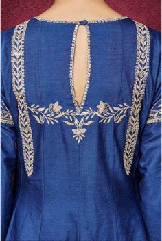 A monga silk blue kurta with exquisite gota patti and resham embroidery with sequin detailing, paired with a chanderi silk blue churidaar and a modal silk dupatta. An elegant anarkali suit, ideal for a light pre-wedding occasion look. Complete the ensemble with golden mojris, chaand balis and a statement jadau ring. Embroidery Suits Punjabi, Kurti Embroidery Design, Embroidery Fashion, Hand Embroidery Designs, Silk Kurti Designs, Kurta Designs Women, Salwar Designs, Back Neck Designs, Dress Neck Designs