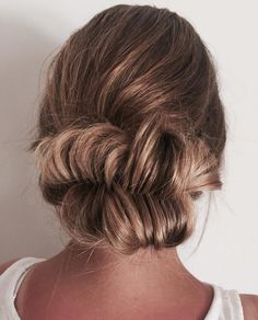Fishtail bun, soft and simple with a touch of elegance via @rjchairdesign using all #NAKhair. #hairinspo #hairgoals #braids #TheNAKCollective