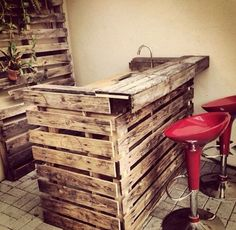 A DIY Man Cave Bar Made From Recycled Palettes