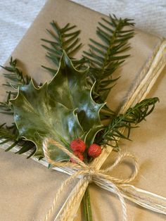 Evergreen Foliage and String  Gather a few lengths of string, tie up the gift and tuck a couple of sprigs of foliage under the bow.