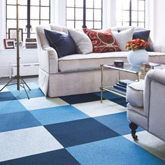 Some kind of fun color FLOR rug in colors that match (black, gray)