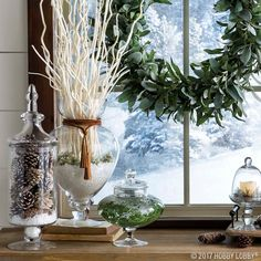 This winter, add warmth to your decor with gorgeous glassware. Fill glass jars with a mixture of snowy greenery and pinecones for added outdoor ambiance!
