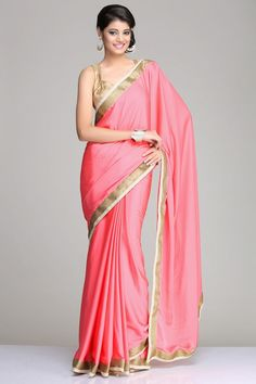 Coral Pink Crepe Saree With A Antique Gold  Border And A Golden Blouse Piece With Sequins