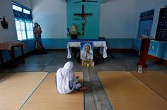 A nun belonging to the global Missionaries of Charity tends to a patient at…