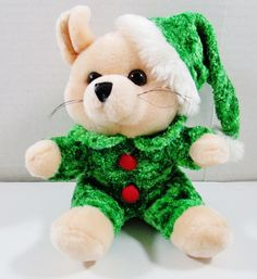 "Wearing a Green Christmas Outfit. Tony Toy Christmas Plush Mouse. Cream colored mouse. This is a well cared for plush animal that remains in great condition with minor to no signs of wear. 7"" Tall. ..... Visit all of our online locations..... www.stores.ebay.com/ourfamilygeneralstore ..... www.bonanza.com/booths/Family_General_Store ..... www.facebook.com/OurFamilyGeneralStore"
