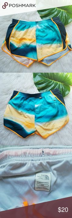 North Face Tie Die Running Shorts The North Face brand.  Women's Large.  Flash Dry - Dri-Fit  Tie-dyed color - Blue, yellow, and white. Blue sides - orange trim.  Built in underwear lining.  Elastic - drawstring waist.  Small zipper pocket in the back. Excellent condition. The North Face Shorts