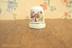 A personal favorite from my Etsy shop https://www.etsy.com/ca/listing/484396529/vintage-porcelain-thimble