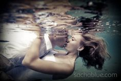 Absolutely LOVE this scene. Great trash the dress photo. Love the dreamy colors and the reflections in the water surface.