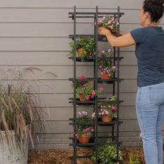 Turn Basic Wood Trellises into an Outdoor Plant Stand - DIY Garden Project - Add farmhouse style to your porch, patio, or deck with this easy-to-assemble planter. This easy wee -