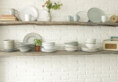 White plates, open kitchen shelves, bliss. More kitchen decorating ideas at Redonline.co.uk