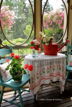 Aiken House & Gardens: Charming porch with a vintage tablecloth, turquoise chairs, and red accents.