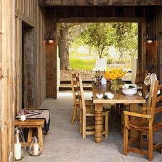 Rustic dining room: This open-air dining room features reclaimed redwood siding