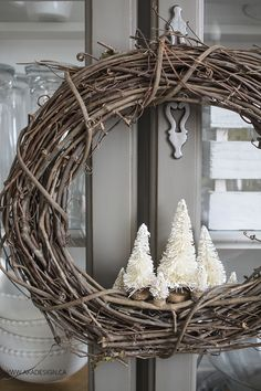 Make your own VERY simple rustic holiday wreath with a grapevine wreath and a few bottle brush trees! MichaelsMakers AKA Design