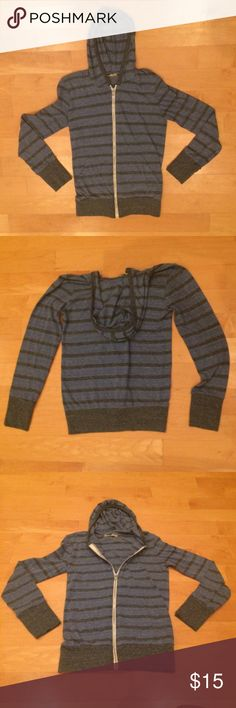 """Alternative Earth Lightweight Zip Up Very soft and comfortable hoodie! Lightly worn, great condition! Blue with grey stripes, cuffs & trim. Chest 32"""", Waist 25"""", Hip 32"""". *Measurements are approximate*                         50% Polyester, 38% Cotton, 12"""" Rayon. Alternative Apparel Sweaters Zip Up"""