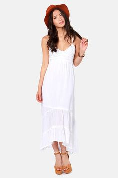 Check it out from Lulus.com! All aboard the train to impeccable style, in the Billabong Railroad Run White Maxi Dress! This gauzy cotton dress is a lightweight dream, with a crocheted, V-neck bodice, and empire waistline that's accented by a raw ruffle and two tiers of white trim. Crinkled skirt flows from gathers into a concave, maxi-length hemline with three tiers of raw ruffles. Spaghetti straps are fully adjustable, and smocked elastic across the back provides a custom fit! Metal logo…