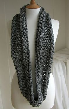 This simple chunky circular scarf is knitted in the round on a circular needle using knit and purl stitches and 5 strands of dk yarn held together. Worn in a wraparound 'figure of eight' style.