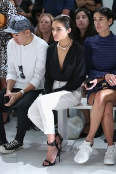 Pin for Later: These Stars Have Been Sitting Pretty in NYFW's Front Row Olivia Culpo Olivia showed us why we'll always be a fan of the wrap-front top as she wore one in the front row. We're also loving that silver choker!