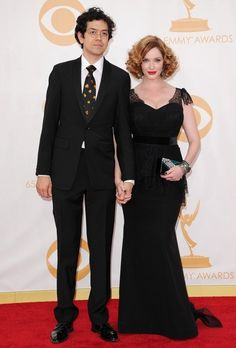 Christina Hendricks and Geoffrey Arend Photos Photos - Red carpet arrivals at the 65th Annual Primetime Emmy Awards at the Nokia Theater in Los Angeles on September 22, 2013. Pictured: Christina Hendricks and Geoffrey Arend. - Arrivals at the 65th Annual Primetime Emmy Awards — Part 2