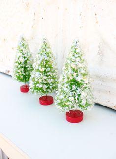 three glittered 3 1/2 inch bottle brush christmas trees. $12.50, via Etsy.