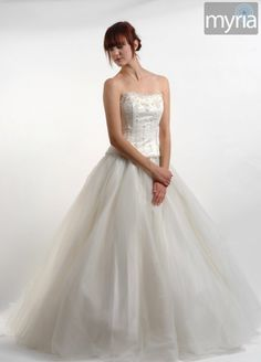 Caitlin in a white sleeveless wedding dress with embroidered bodice and tulle skirt