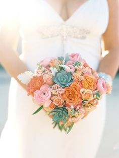 Colorful + beachy succulent bouquet: Photography : Wendy Laurel Read More on SMP: http://www.stylemepretty.com/little-black-book-blog/2016/07/25/dream-hawaiian-beach-elopement/