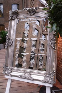 Large mirror on white easel with hand-written table plan by www.stressfreehire.com #venuetransformers